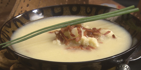 Creamy Cauliflower Soup Heightened with Aged Cheddar, Pancetta, and Sauteed Leeks