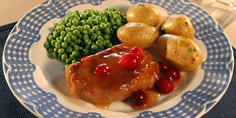 Pork Chops and Simmered Fresh Cranberries with Potatoes and Peas
